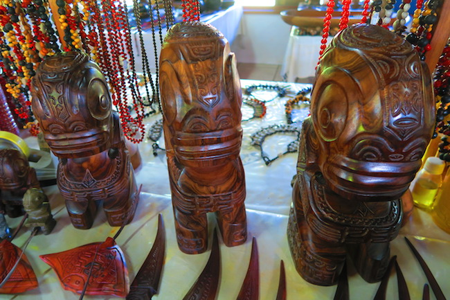 tiki statues arts market nuku hiva marquesas islands