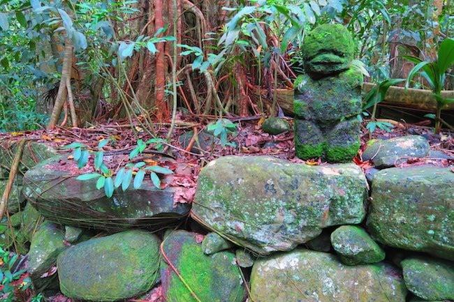 vaipo waterfall hike nuku hiva - tiki statue