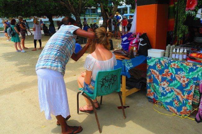Hair braiding in Port Vila Central Market - Vanuatu