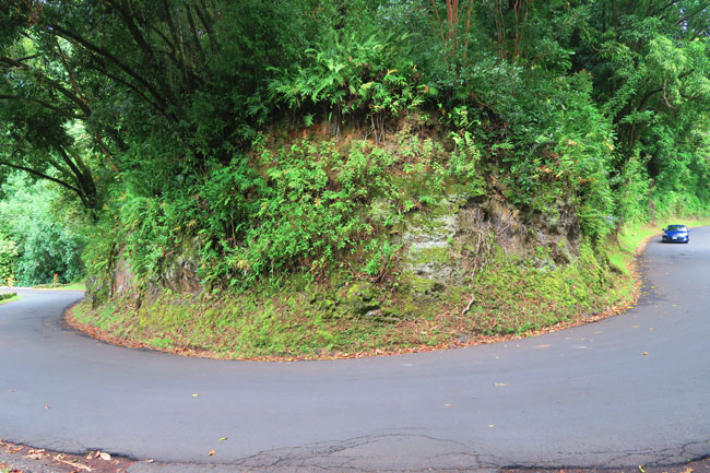 Sharp turn on the scenic Road to Hana - Maui Hawaii