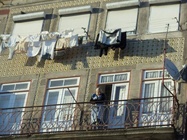Cai Ribeira - Porto - Portugal - Old Woman hanging laundry