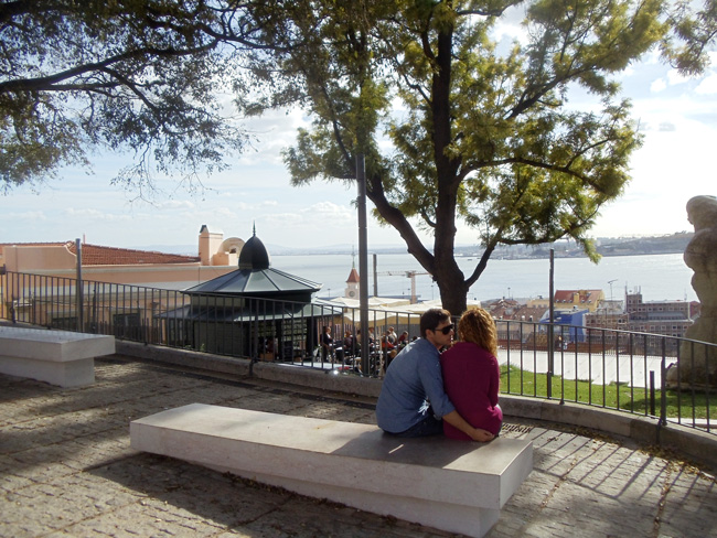 Couple in romantic Miradouro de Santa Catarina - Lisbon