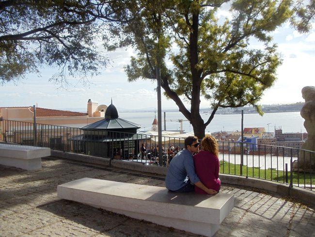 Couple in romantic Miradouro de Santa Catarina - Lisbon