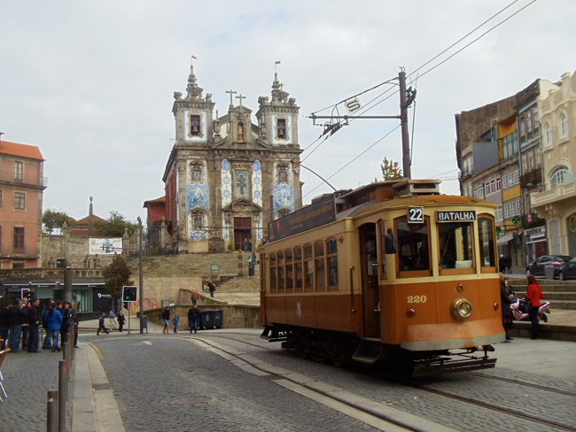Tiled church of Santo Ildefonso and street tram - Porto - Portugal