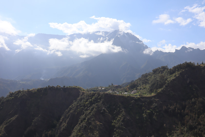 Scenic Drive to Cilaos Reunion Island - remote hamlet and clouds