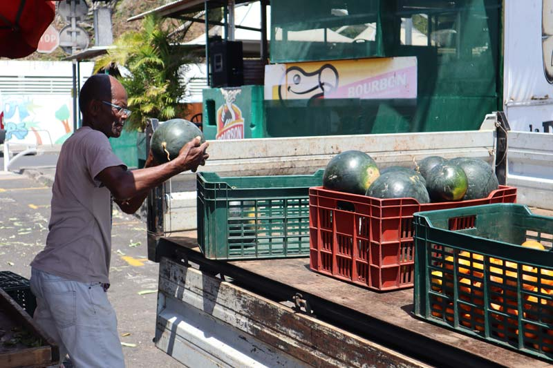 St Paul market Reunion Island - local carrying watermelon