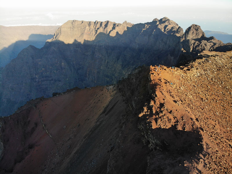 Summit of Piton des Neiges Hike - Reunion Island - Hikers at summit from above