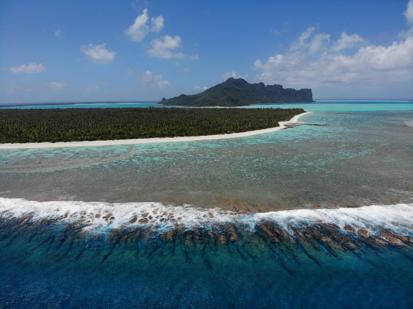 Aerial view of Maupiti coral reef and main island - French Polynesia