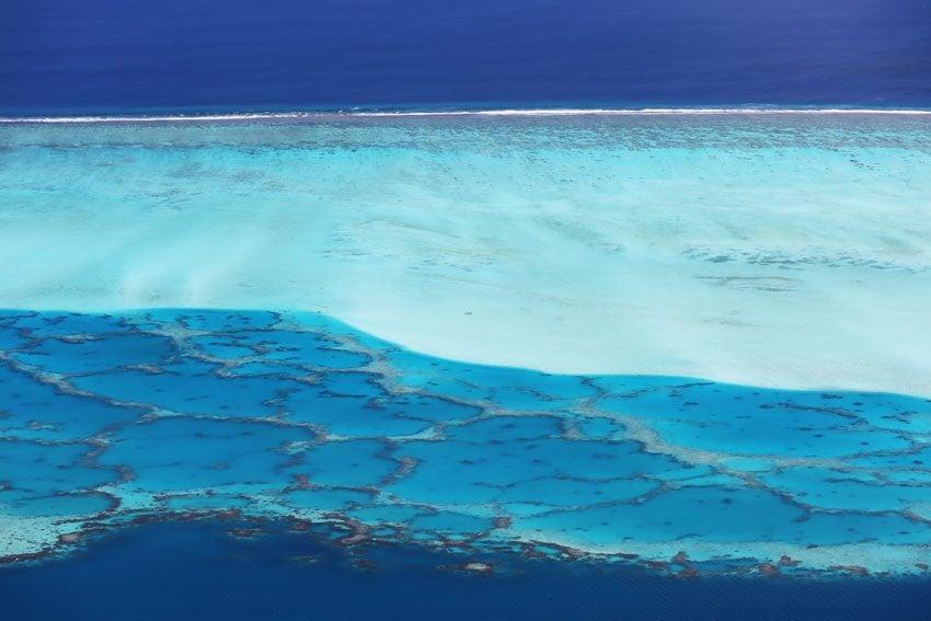Natural pools in Maupiti lagoon from Mount Teurafaatiu hike - French Polynesia