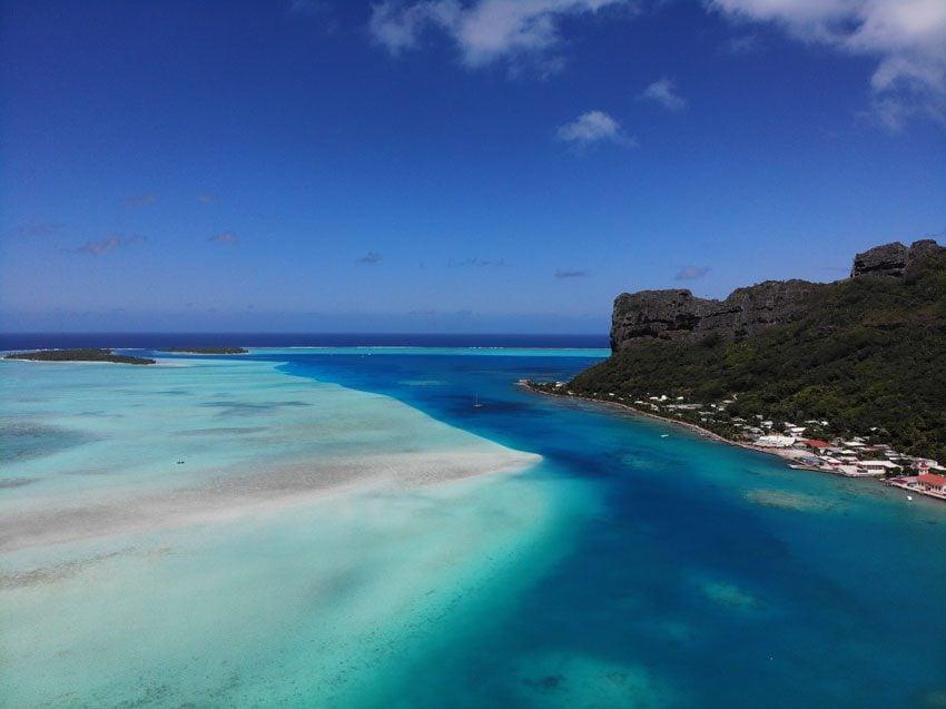 View of Vaiea Village and lagoon from Mount Teurafaatiu hike - French Polynesia - Maupiti