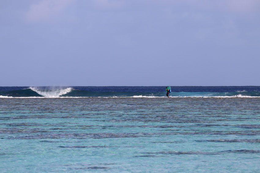 fisherman walking on reef - Maupiti - French Polynesia