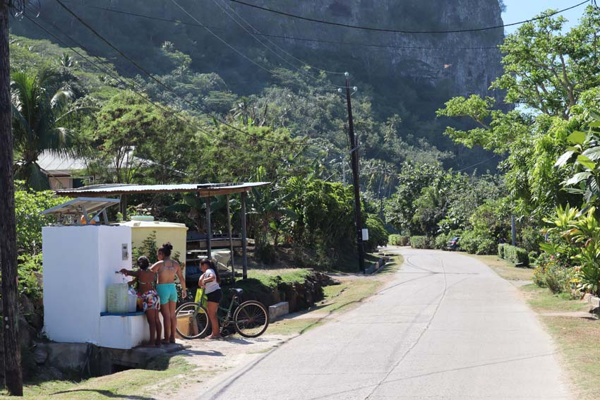 locals getting water in Maupiti French Polynesia