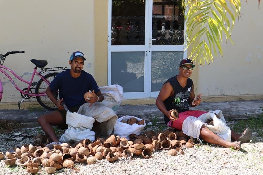 locals making copra in Maupiti French Polynesia