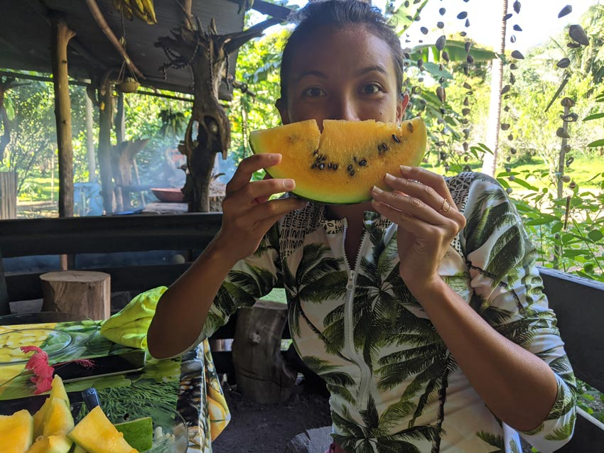 dricia eating yellow watermelon - Hakaui Valley - nuku hiva - marquesas islands - french polynesia