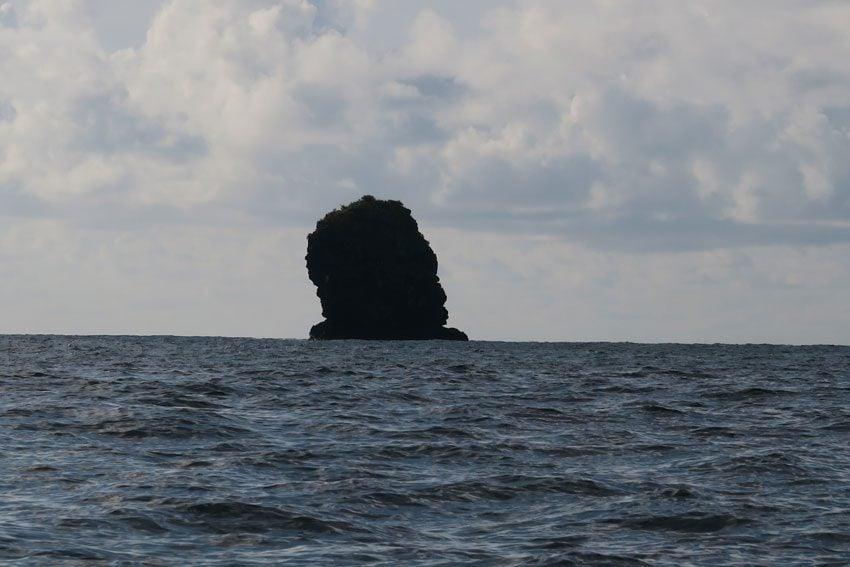 rock with man and woman Hanaiapa Village - Hiva Oa Marquesas Islands French Polynesia