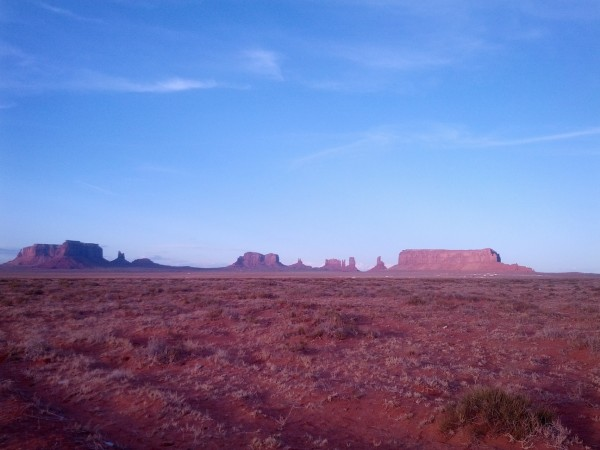 Straight desert road to Monument Valley